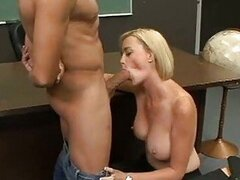 Lusty blonde teacher Camryn Cross takes a meaty shaft in her mouth and loves it