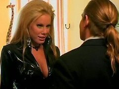 Busty Nicole Sheridan Sucks Evan Stone's Cock Wearing a Sexy Leather Outfit