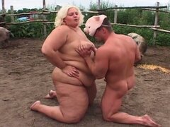 Bbw fucked in the pig farm while pigs look on