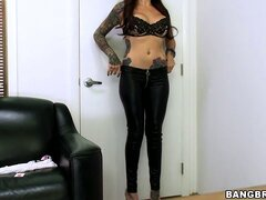 Stripping her clothes, she reveals her curvy tattooed body and tight peach