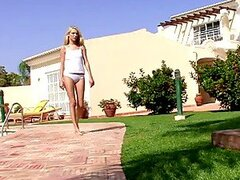 Blonde Chick Peeing In The Garden.