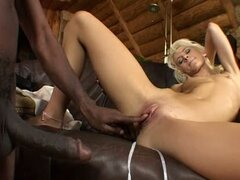 Lovely Cora Carina gets pounded by Black guy on a sofa