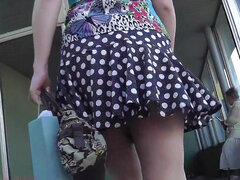Small peek up a chick's skirt