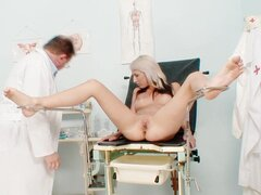 Young blonde goes to gynecologist