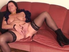 Granny with lots of toys has solo sex