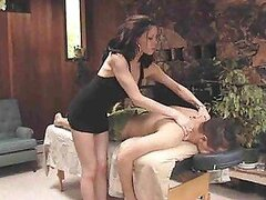 A slutty brunette masseuse likes to massage her men and then ride them
