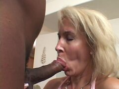Erica Lauren spreads her lips around this huge prick