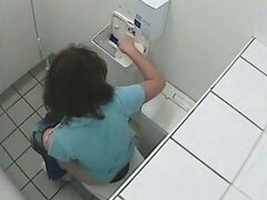 Girl pissing on toilet sitting on bowl back to the cam