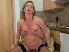 Horny mature blonde honey Laura Long enjoys in her passionate kitchen sex with her young lover, getting her shaved mature pussy licked and sucking a hard boner as well.