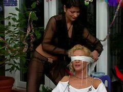 Pouring sticky stuff on bound women