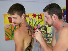 Andrew Stark has the lucky job of applying body paint on JD Phoenix's luscious body.  With his face near JD's bubble butt, Andrew can't help but take a little lick. Caught off guard, the advance causes JD to spin around and mess up the artwork!  The guys