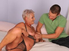 A guy has a camera and films his skanky old granny getting naked and riding his rod