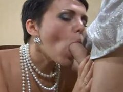Russian cougar get fingered and sucks cock