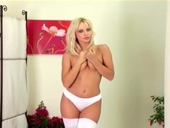 Stripping out of her bra and panties then fingering in thigh highs and heel