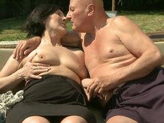 Dark-haired granny Margo T. gets fucked by two guys outdoors