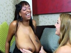 Big, ebony lesbian with ginormous tits toys white girl's wet cunt