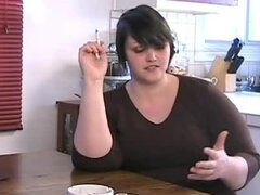Adorable BBW Mila enjoying a smoke at dinner table