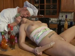 Blonde busty babe is fucked by her friend in the kitchen. Hot video