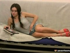 Teen girl gets turned on by a magazine