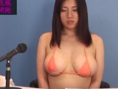Azusa Hagasawa lets two dudes play with her tits and pussy
