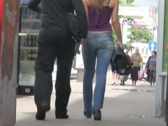 Bubble butt brunette rocks her tight jeans before a candid camera