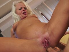 Mature blonde being fucked...