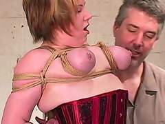 Tied up girl in tight red corset