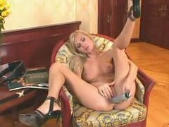 May the horny blonde in miniskirt masturbates on an armchair