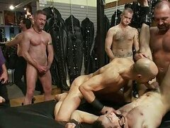 Tattooed gay stud gets tied and dominated by group of horny gay hunks