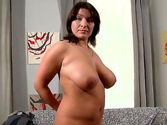 Amateur MILF Sophia Moroe gets her giant white tits out. This sexy brunette gives us a slow sizzling striptease as she shows off her naked body. she even gets her brown nipples all hard and she takes a good lick of them.