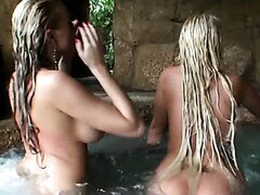 These two amazing blondes are very busty and horny. Watch them having some lesbian fun in the pool.