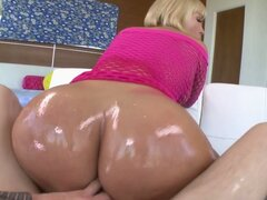 Blonde pornstar gets her oiled butt pounded from behind
