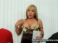 Lusty mature blonde Luna Azul shows these studs a thing or two about blowjobs
