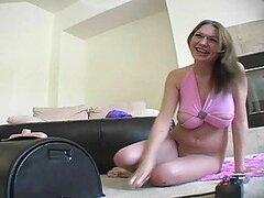 Hot blonde with big natural boobs is on vibrating machine