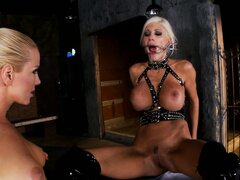 Sandy is at the mercy of her dominatrix, with all the tools and toys