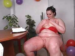 Big birthday girl masturbates with her cake