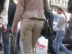 Round and tight woman ass in brown pants voyeur video