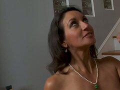 Classy milf Persia Monir sucking young dick on her knees wearing pearls on her neck