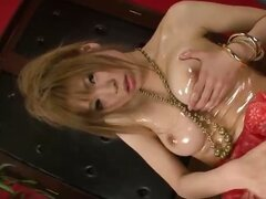 Ai Sakura oils up her big tits and juicy pussy to make herself cum