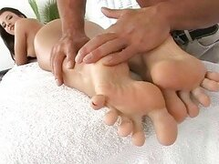 Teen enjoys hot foot massage