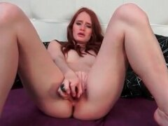 Redhead fucks two dildos in her cunt
