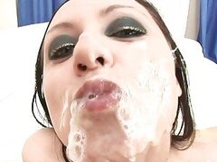 Hot brunette receives a nice explosion of cock sauce allover her face