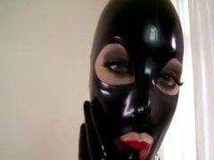 Latex beauty enjoys cock