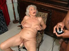 A white haired grandma ain't done with sex yet as she's fucked by a machine