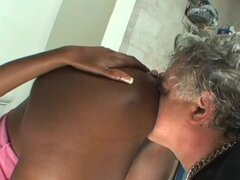 Busty ebony enjoys pissing fetish