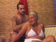 Mature and hot doll Carla in bikini is having deep fuck with her young bf
