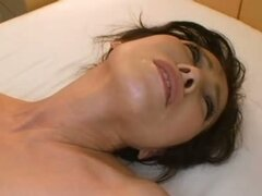 Japanese milf has her pussy played on