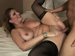 MILF with massive tits takes a rough pounding from a young stud