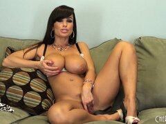 Lisa Ann chats more and poses showing off her hot, fuckable body