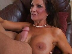 Naughty busty brunette milf sucking huge dick